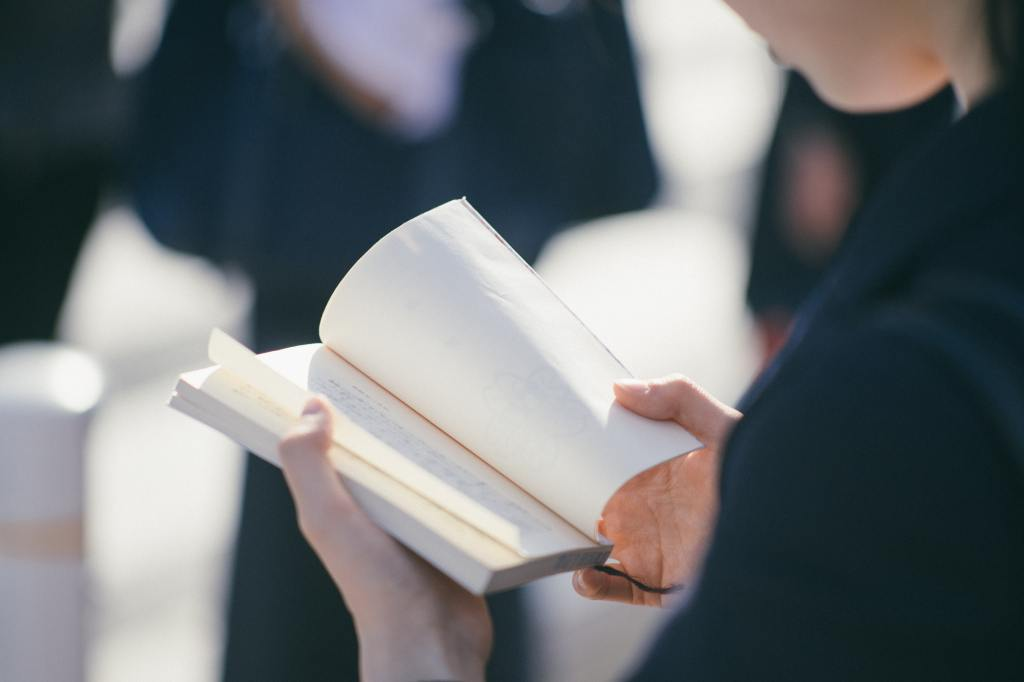 A woman reading a book other than Genki I & Genki II