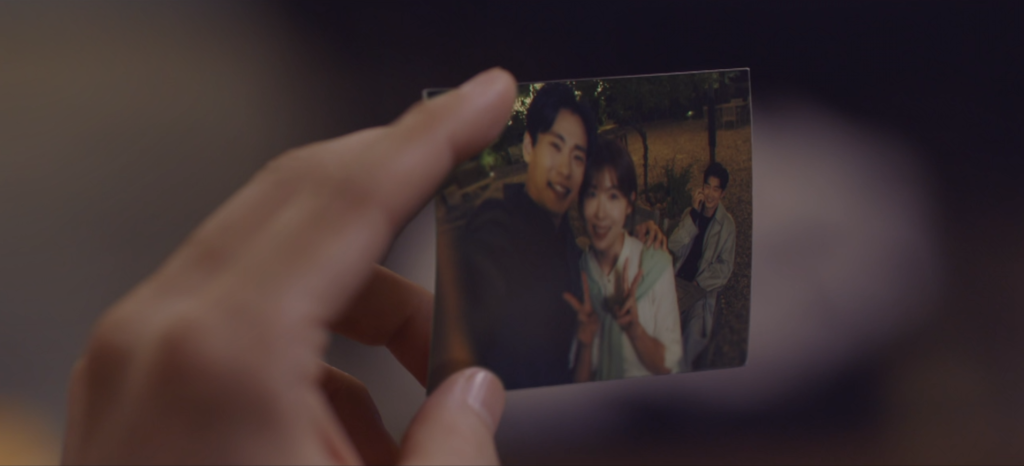 Min Seong finds a photo in Cha Young's wallet of the couple blurred out with the focus on his best friend Lee Kang...from the Chocolate Kdrama